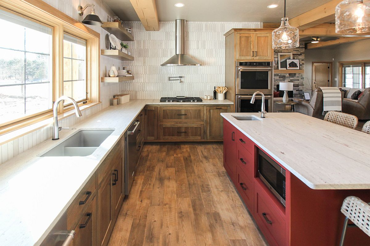 Dashing deep red kitchen island steals the show in this rustic kitchen