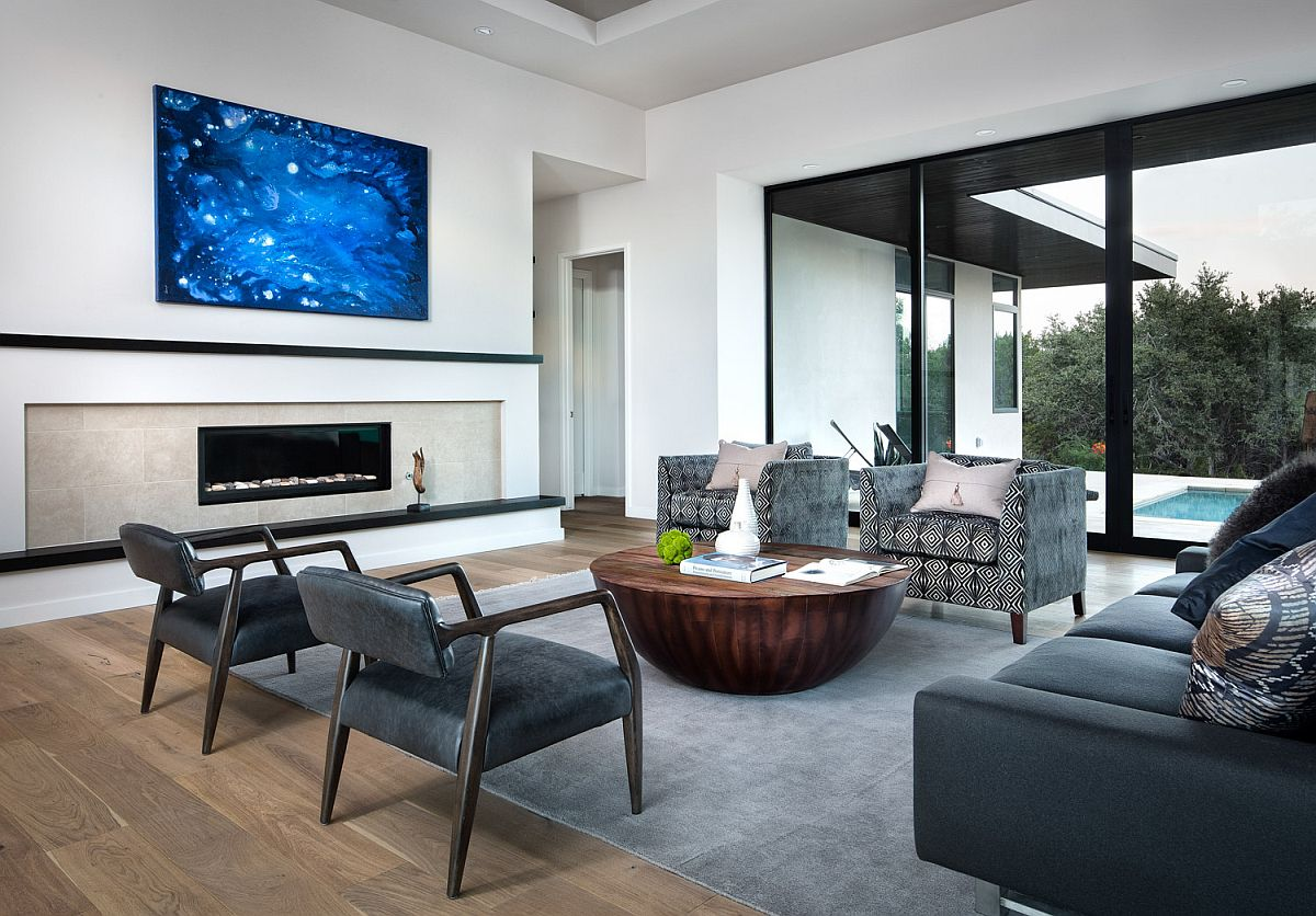 Dashing slim fireplace is at the heart of this living area connected with the pool and courtyard