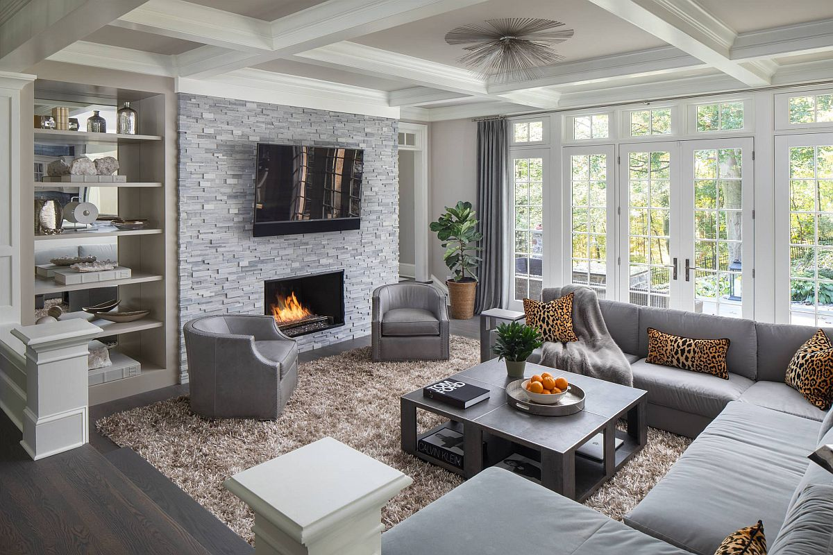 Decor and drapes bring different shades of gray to this luxurious living room