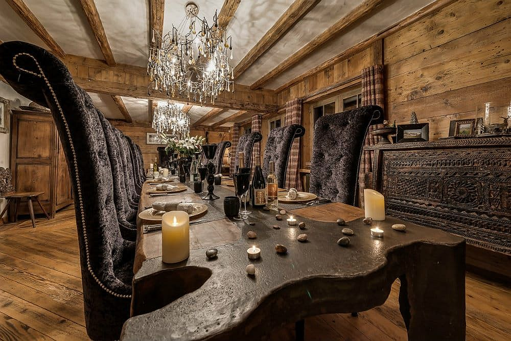 Dining-space-of-the-luxurious-chalet-with-large-wooden-dining-table-and-a-fabulous-credenza-in-the-backdrop-40087