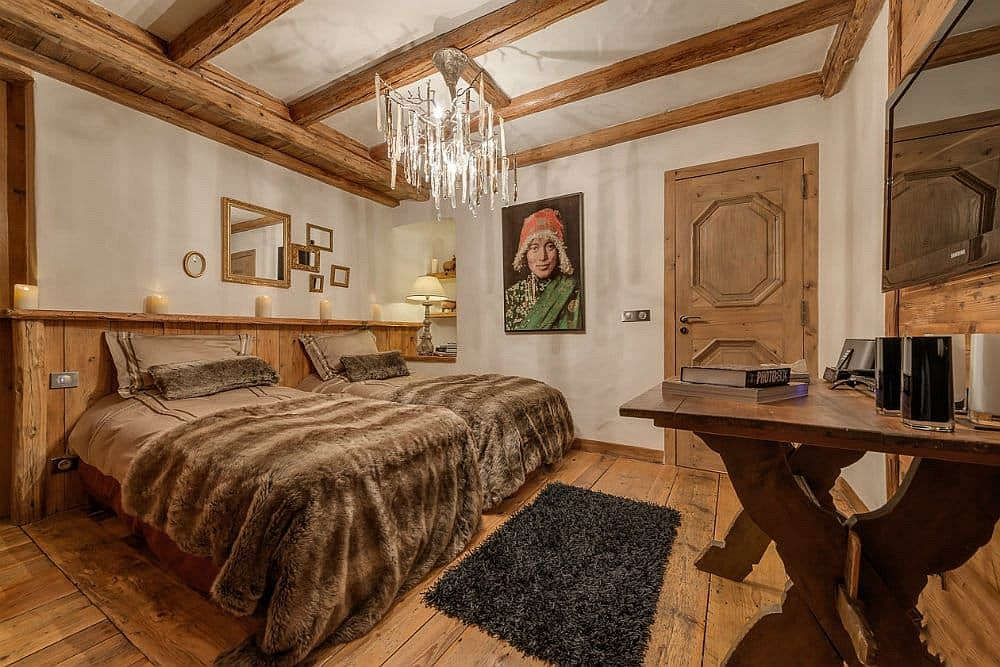 Discover the many beautiful bedroom at the Chalet Le Rocher