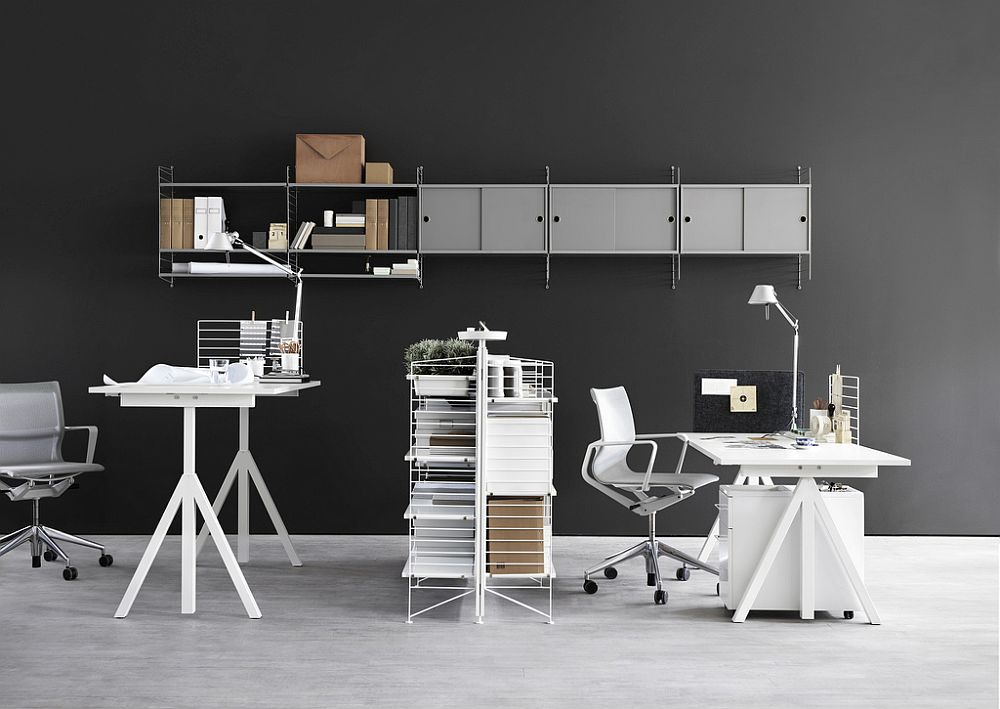 Easy-to-use sit-stand desks coupled with string shelving system create fabulous office space compositions