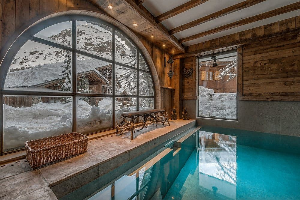 Enjoy the snow outside even as you take a dip inside the indoor pool