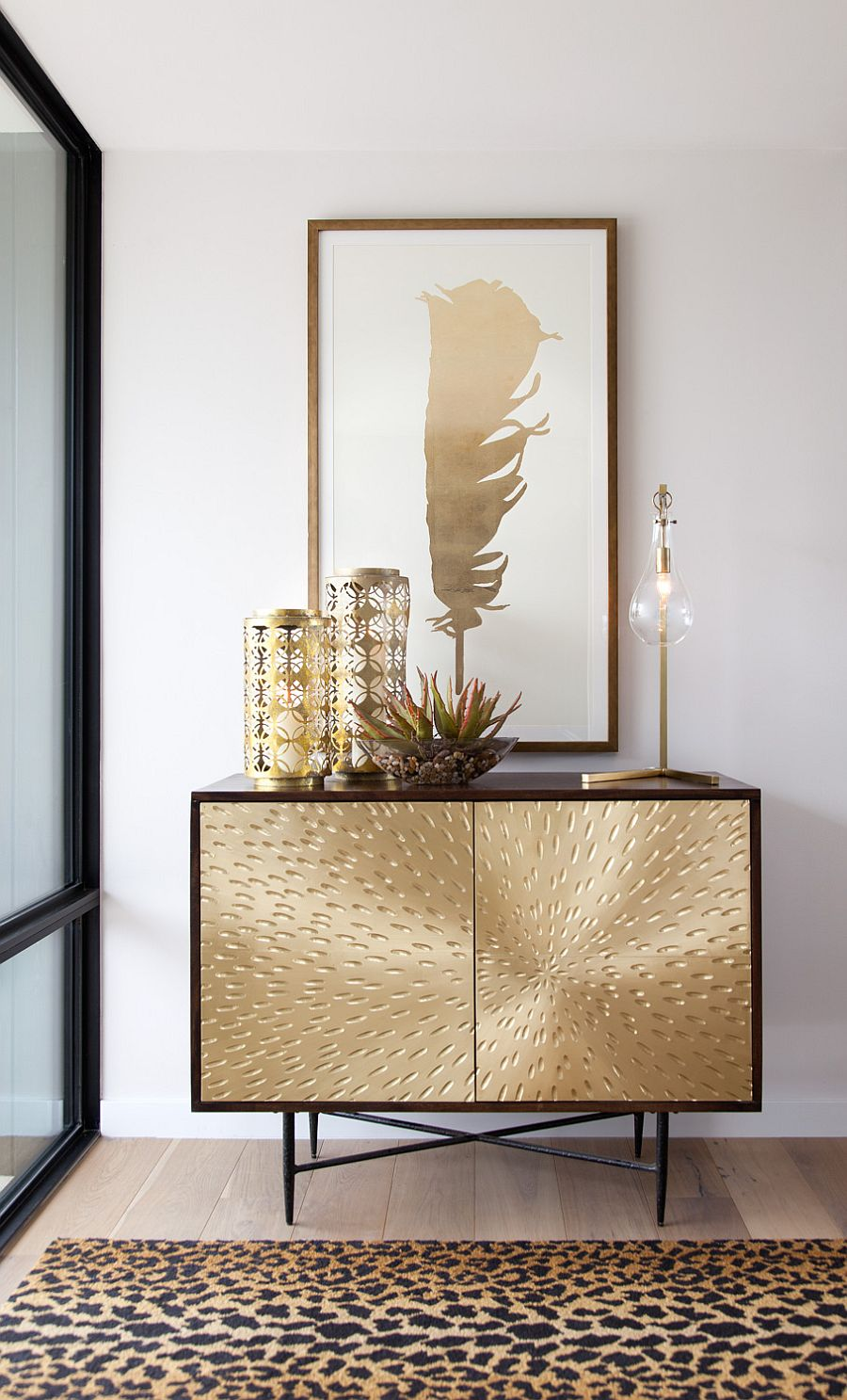 Entry foyer with a fabulous golden console table and lovely decorative pieces