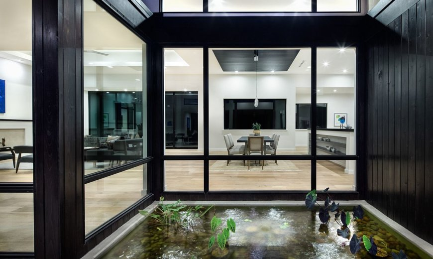 Expansive Rear Courtyard and Polished Entry Shape this Lavish Texas Home