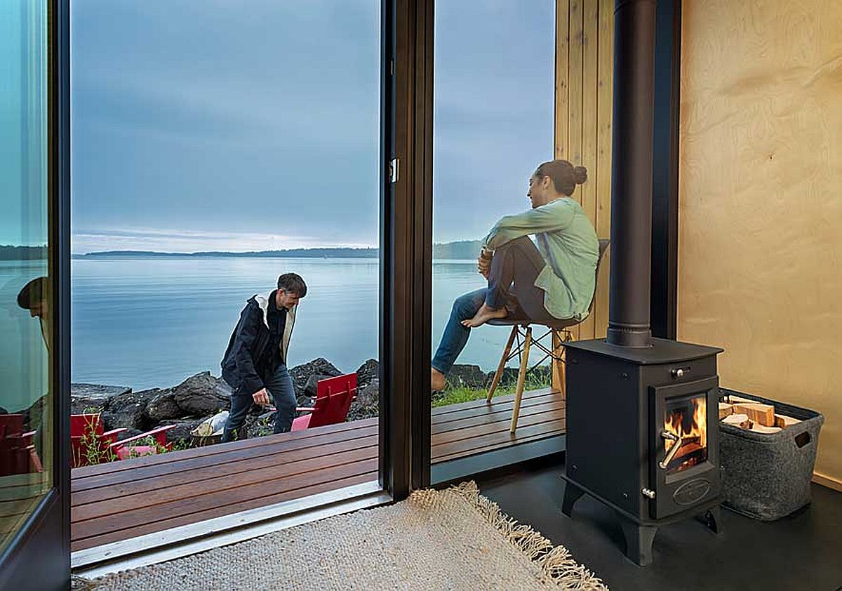 Fireplace in the corner of the tiny cabin sitting area