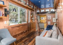 Fold-down-wooden-desk-and-floating-library-shelves-make-this-cabin-ideal-for-writers-52899-217x155