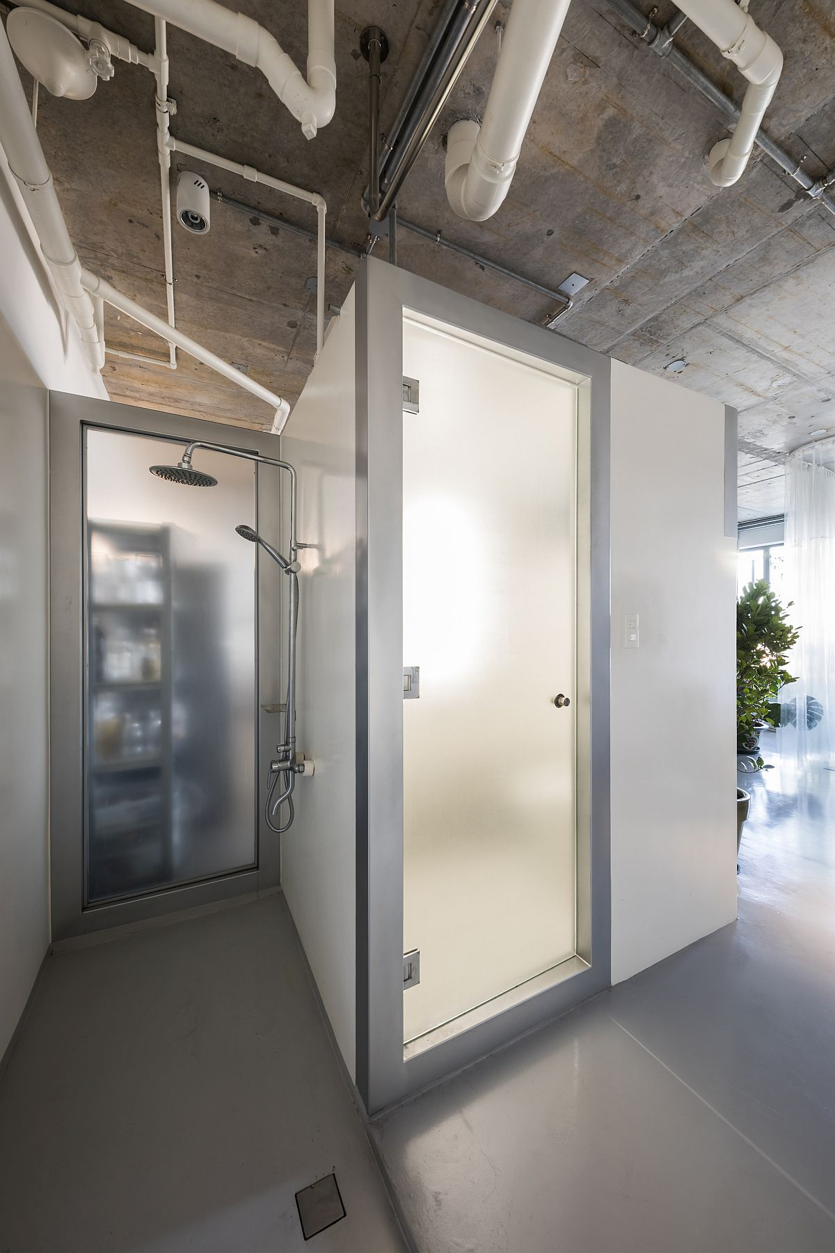 Frosted glass doors inside the apartment combine privacy with proper ventilation