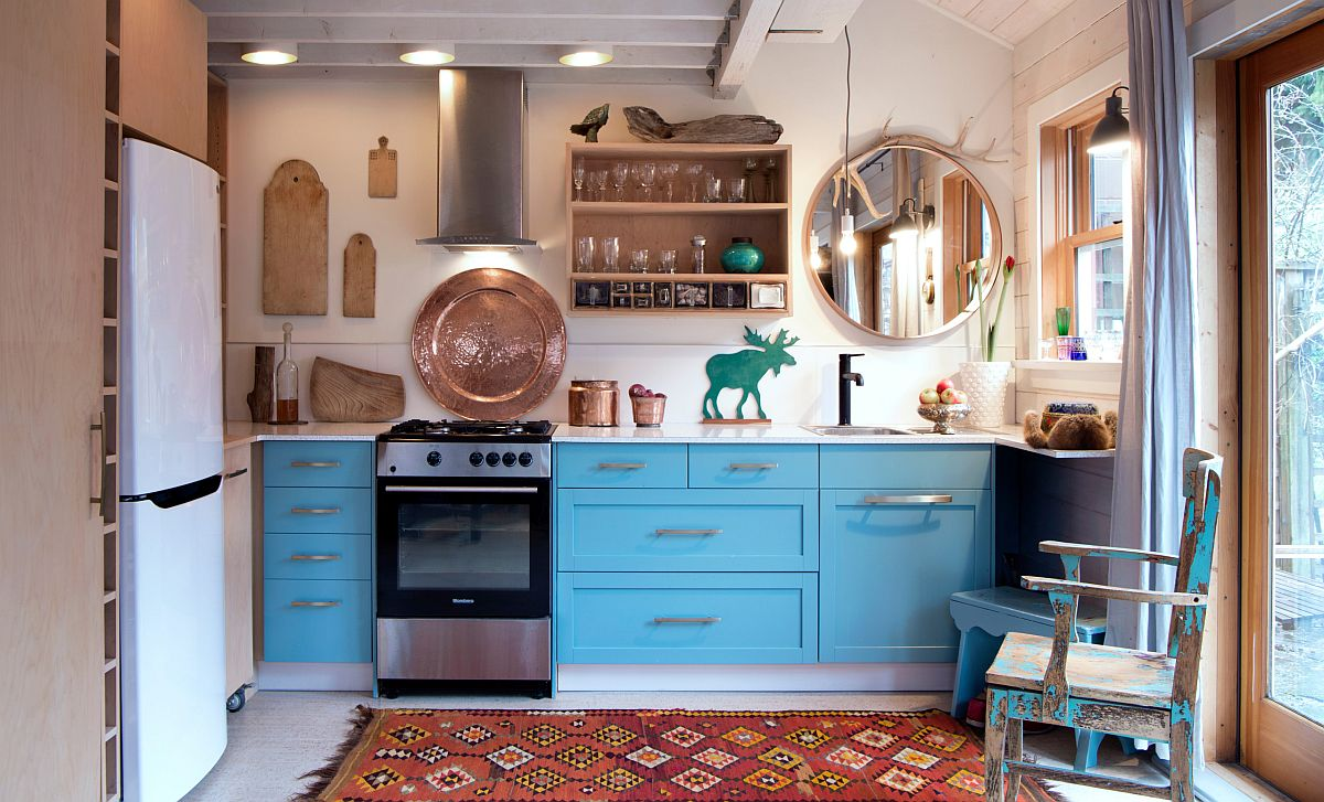 Fun blue cabinets in the kitchen add color and contrast to the small rustic kitchen