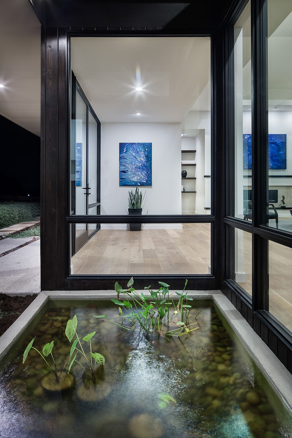 Glass windows bring the gorgeous courtyard water feature indoors!
