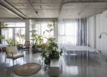 Gorgeous-world-of-green-sits-between-the-grey-epoxy-floor-and-the-exposed-concrete-ceiling-23837-217x155