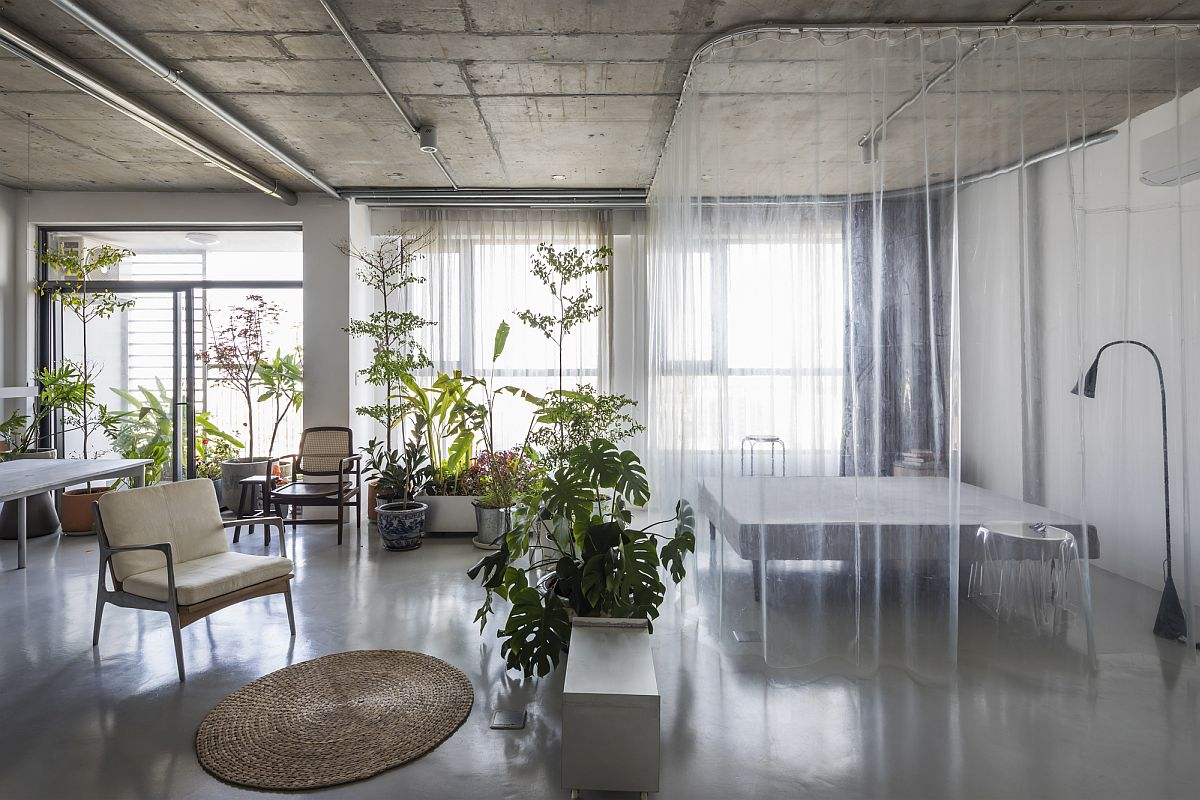 Gorgeous world of green sits between the grey epoxy floor and the exposed concrete ceiling