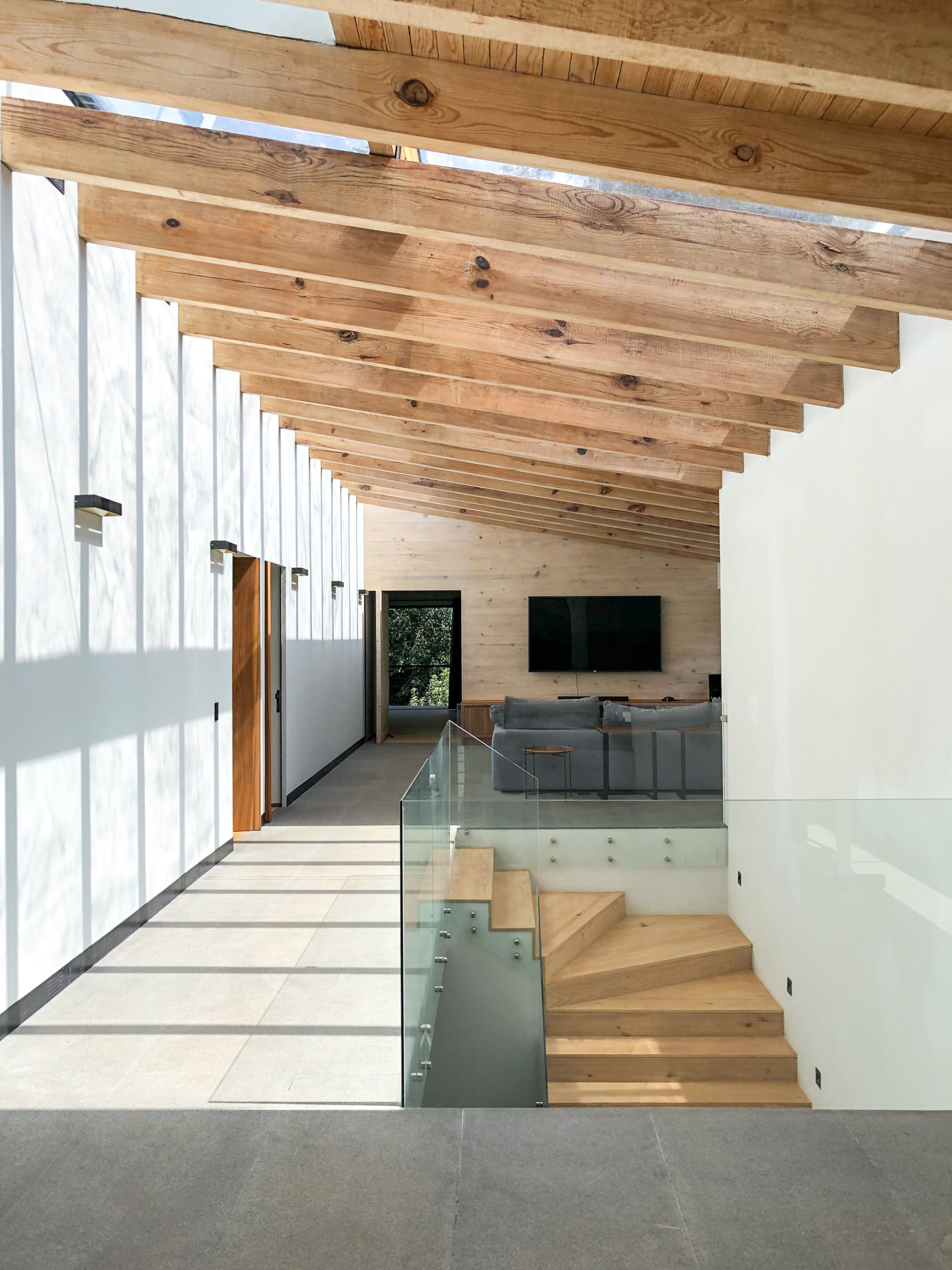 Interior of the expansive green home in Valle de Bravo draped in wood, white and glass