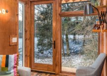 Large-glass-doors-and-windows-bring-light-into-the-small-cabin-16457-217x155