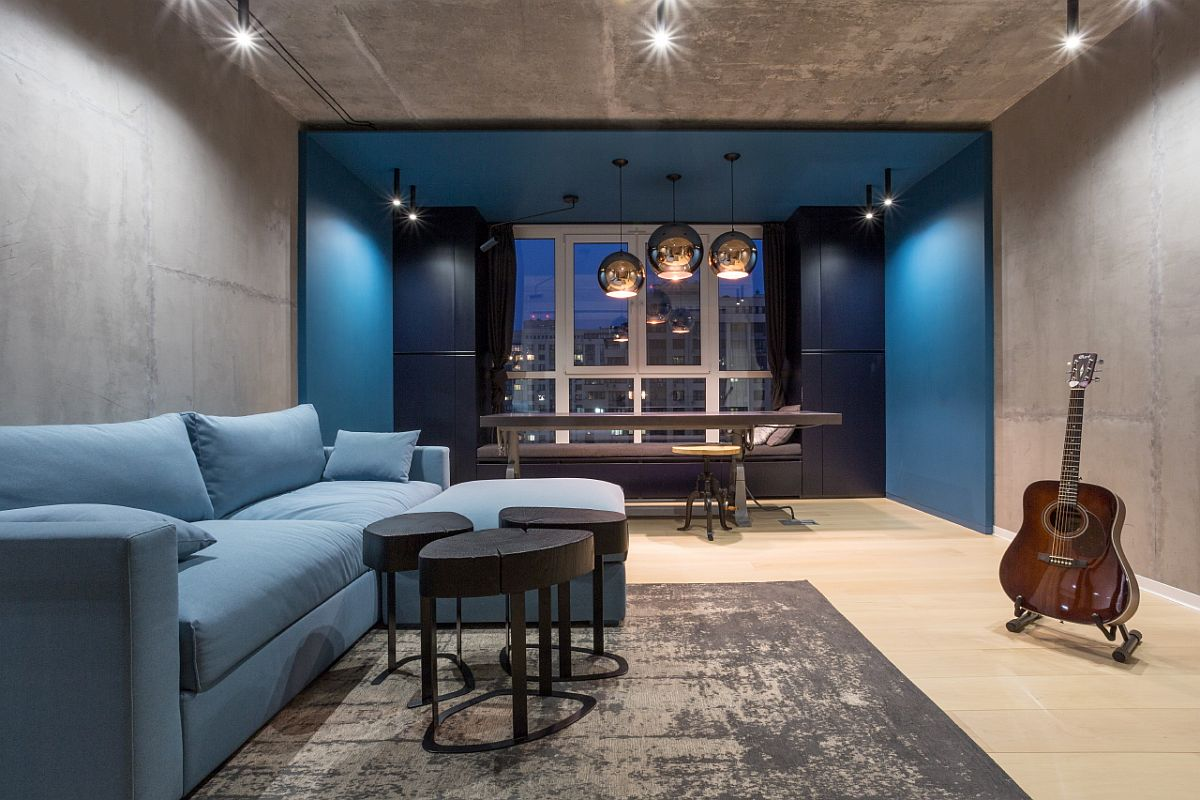 Large sectional in blue for the family area along with a charming dining space