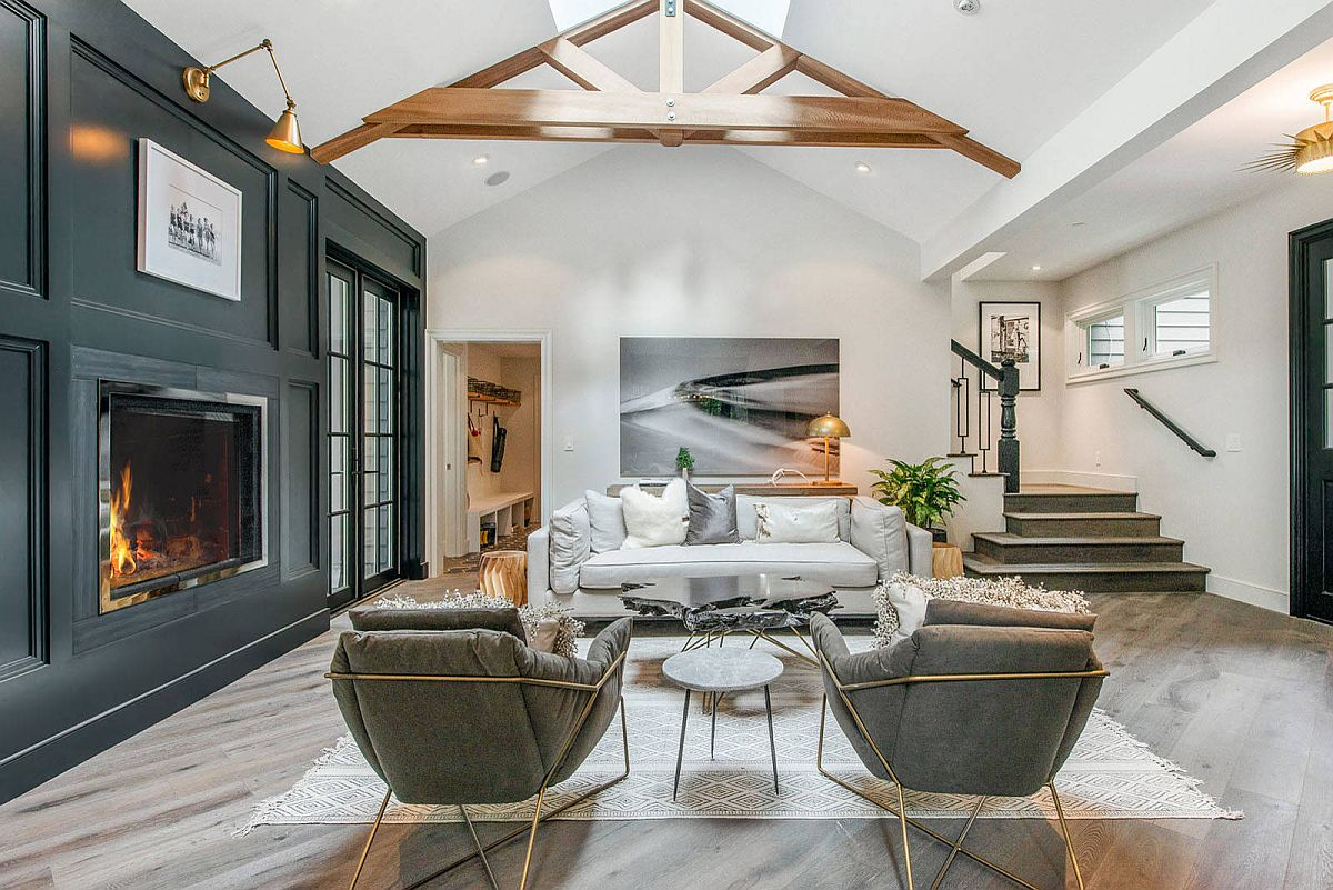 Large skylight coupled with a vaulted ceiling gives this living room a spacious look