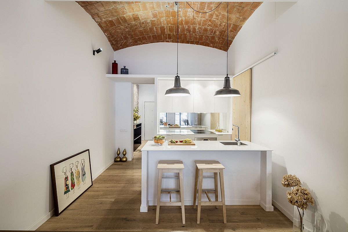 Lighting makes a big difference to this transformed Barcelona home with unique vaulted ceiling