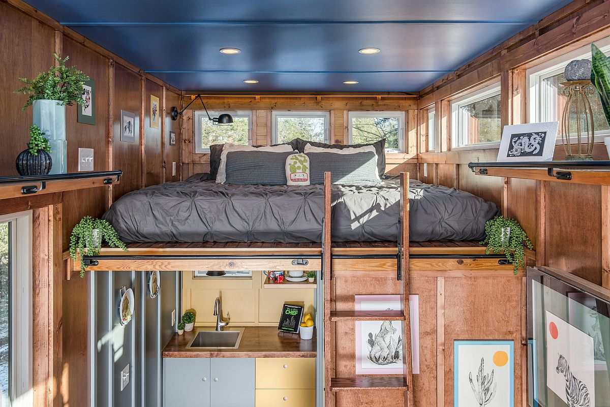 Loft bed with sconce lighting easily provides space for two
