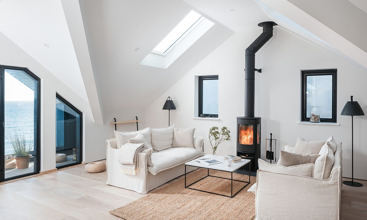 Lovely-little-living-room-in-white-with-a-beautiful-firepace-is-just-picture-perfect-25594