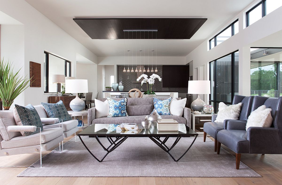 Luxurious open plan living area with neutral color scheme and simple blue accents