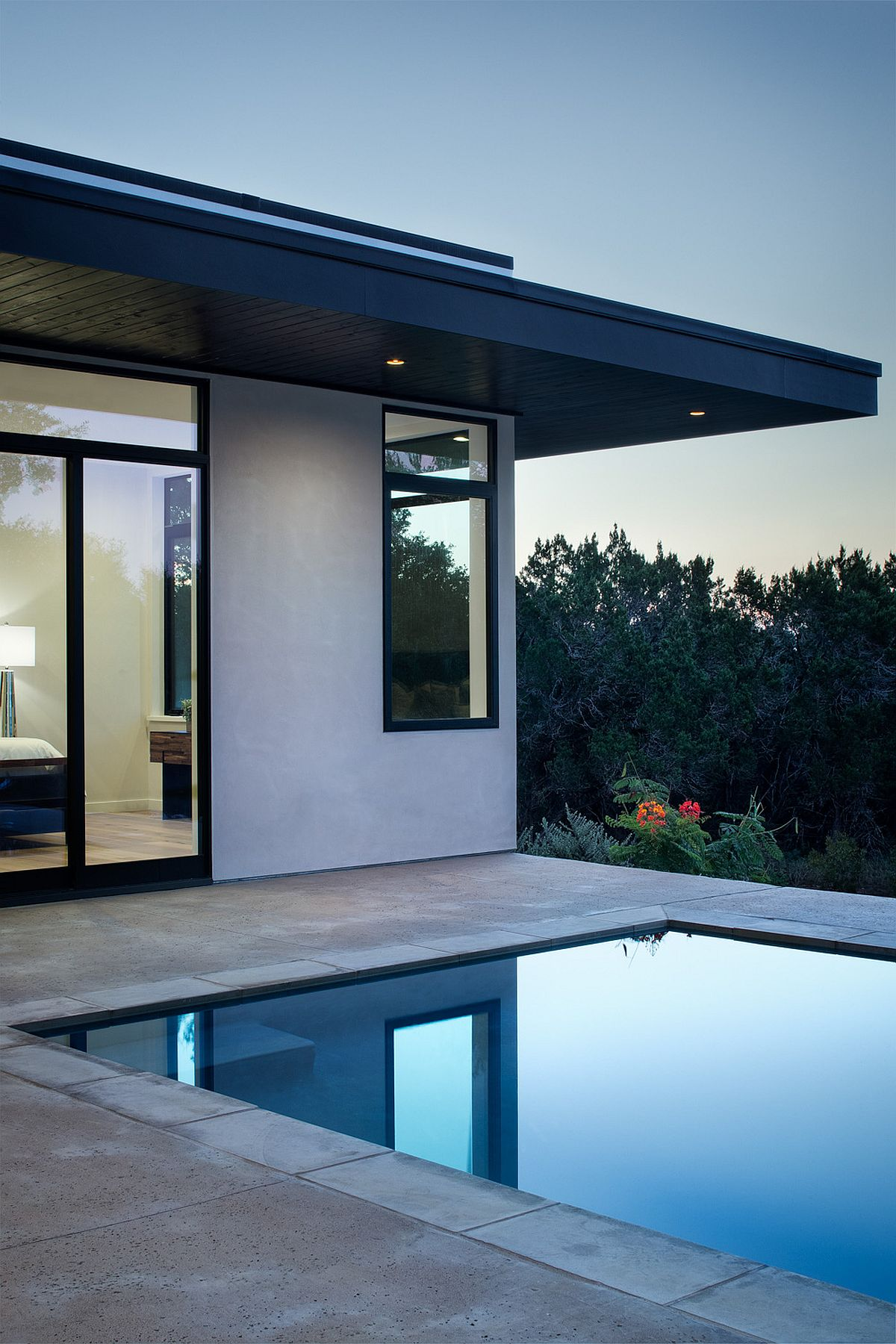 Master suite of the home with access to the pool area offers mesmerizing views