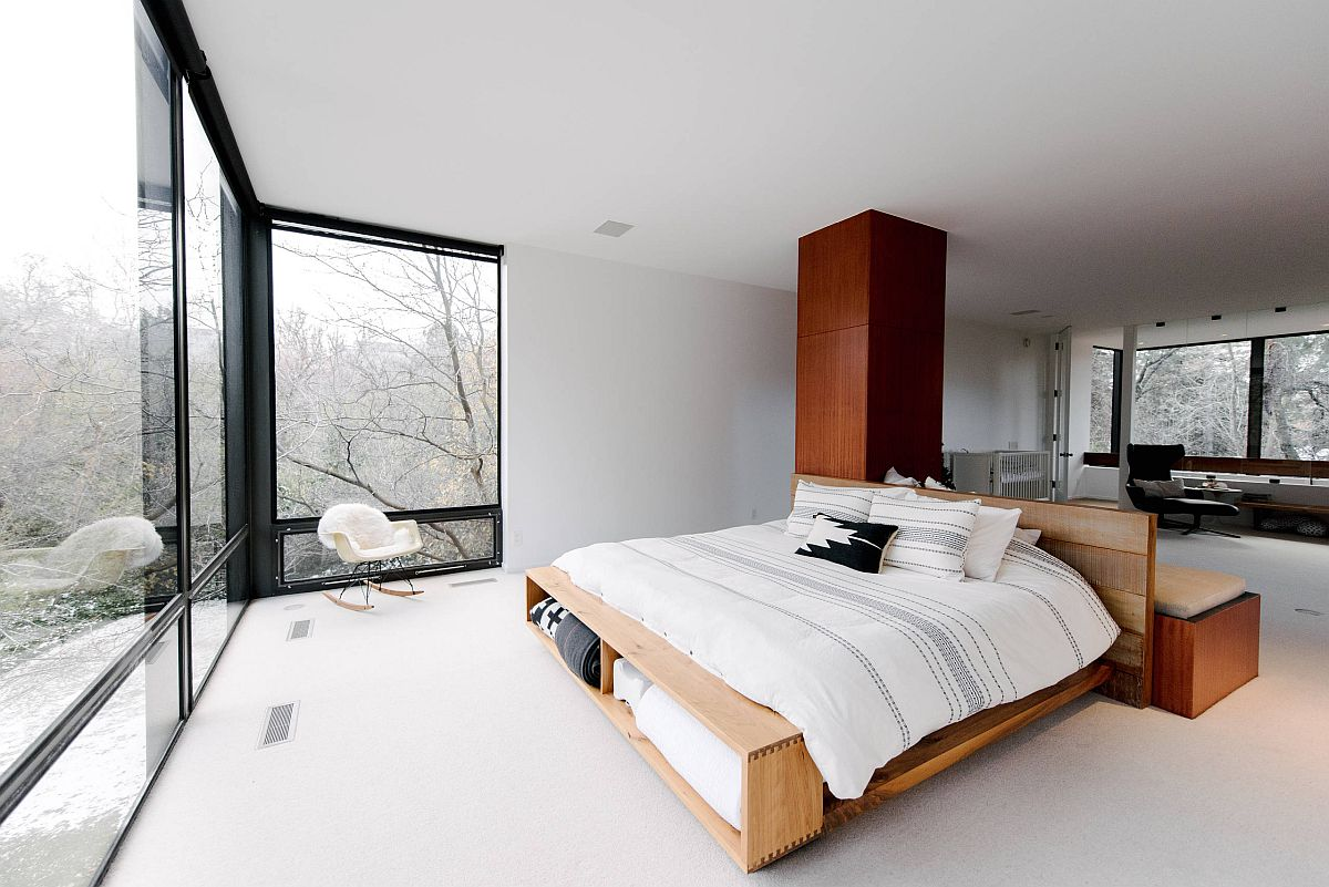 Minimal bed framed with storage is perfect for this exquisite bedroom with contemporary style