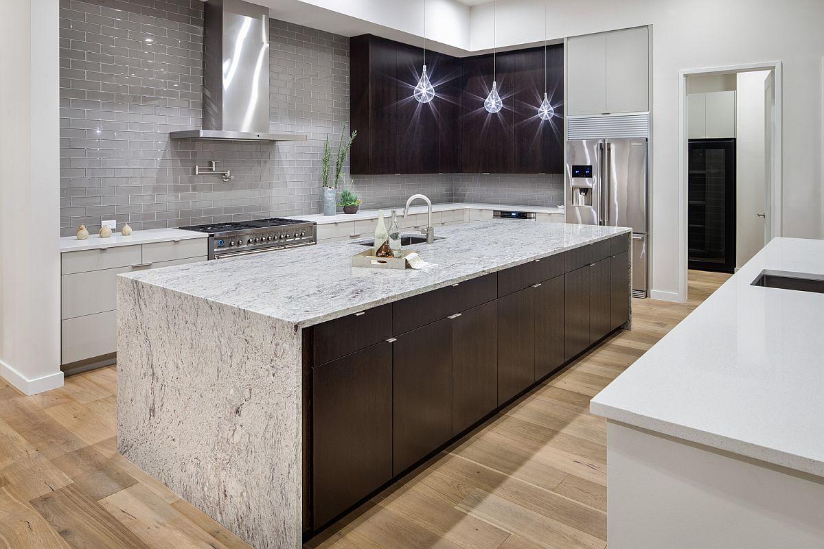 Modern kitchen with stone island, Edison bulb lighting and a striking gray backsplash