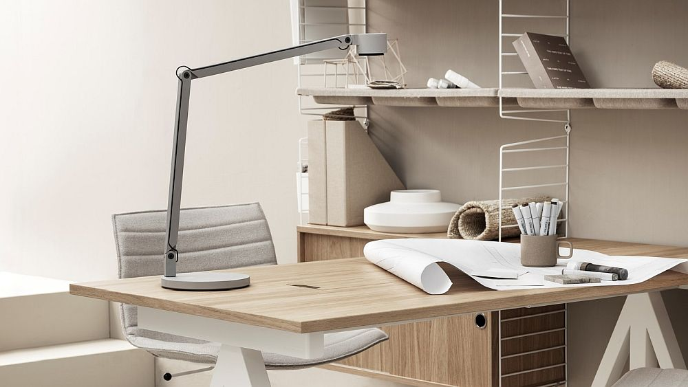Oak table and finishes add wramth to this contemporary home office setting from String