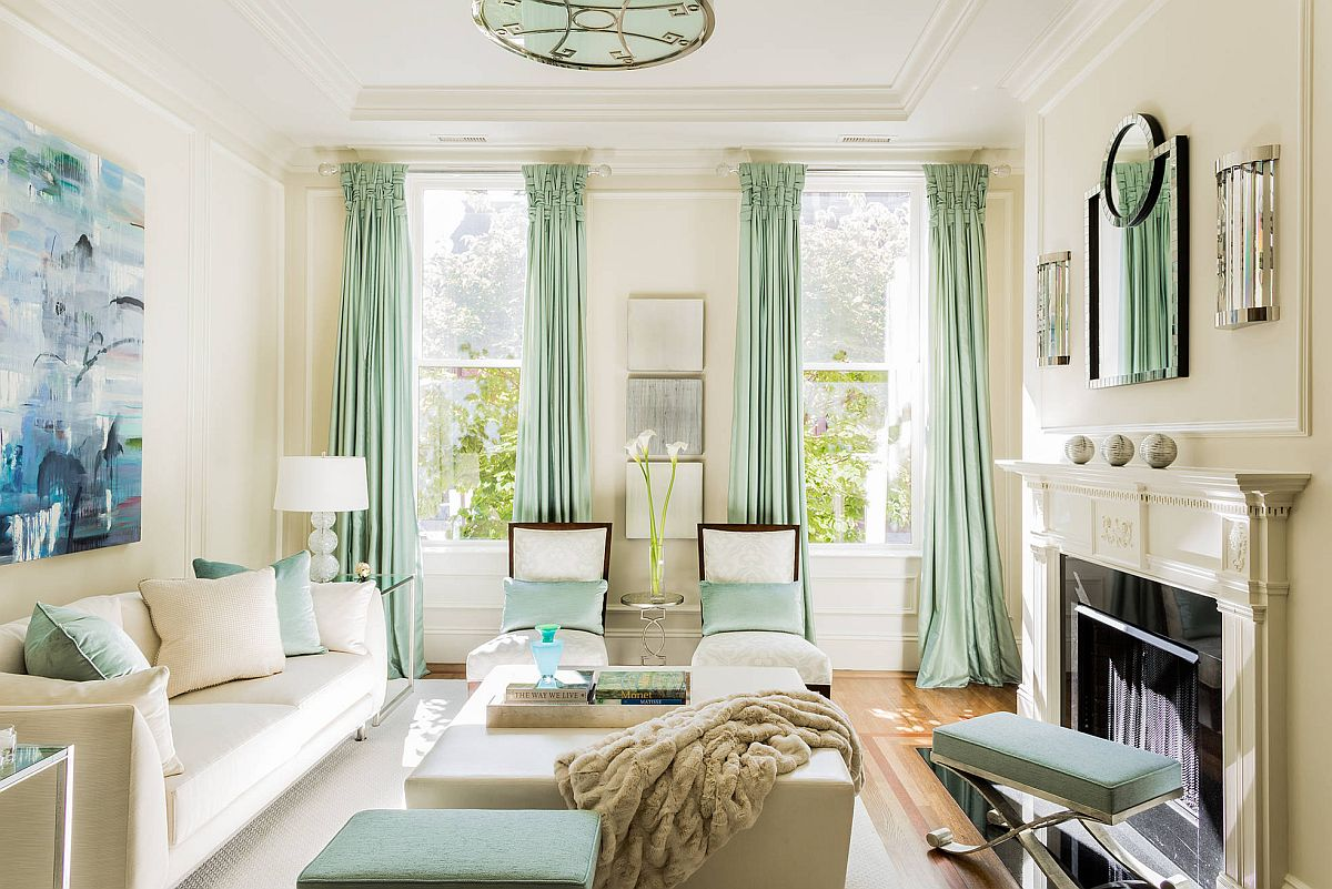 Pastel curtains and throw pillows add color in a gentel fashion to the living room
