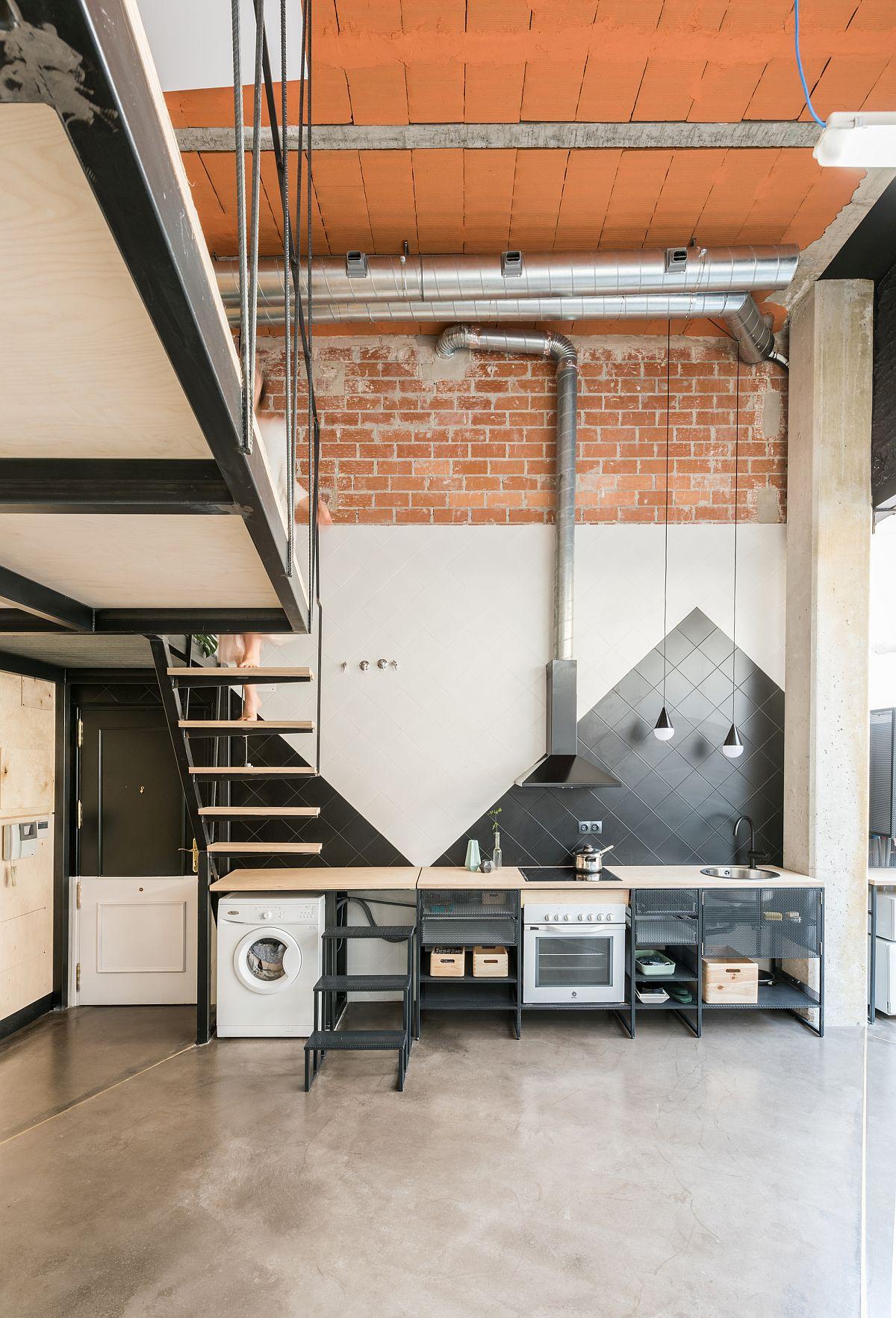 Polished black and white single-wall kitchen idea inside the ground level Madrid apartment