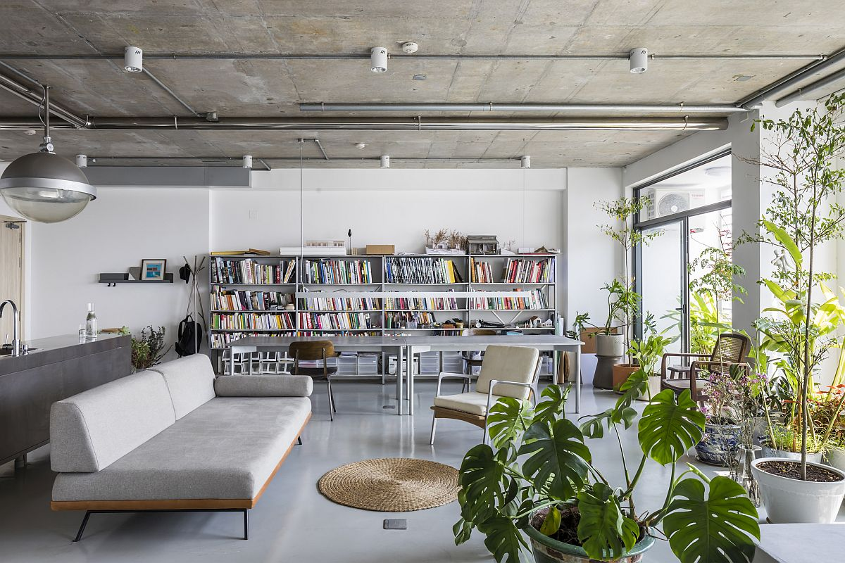 Renovated apartment in Ho Chi Minh City with plants and books dominating the interior