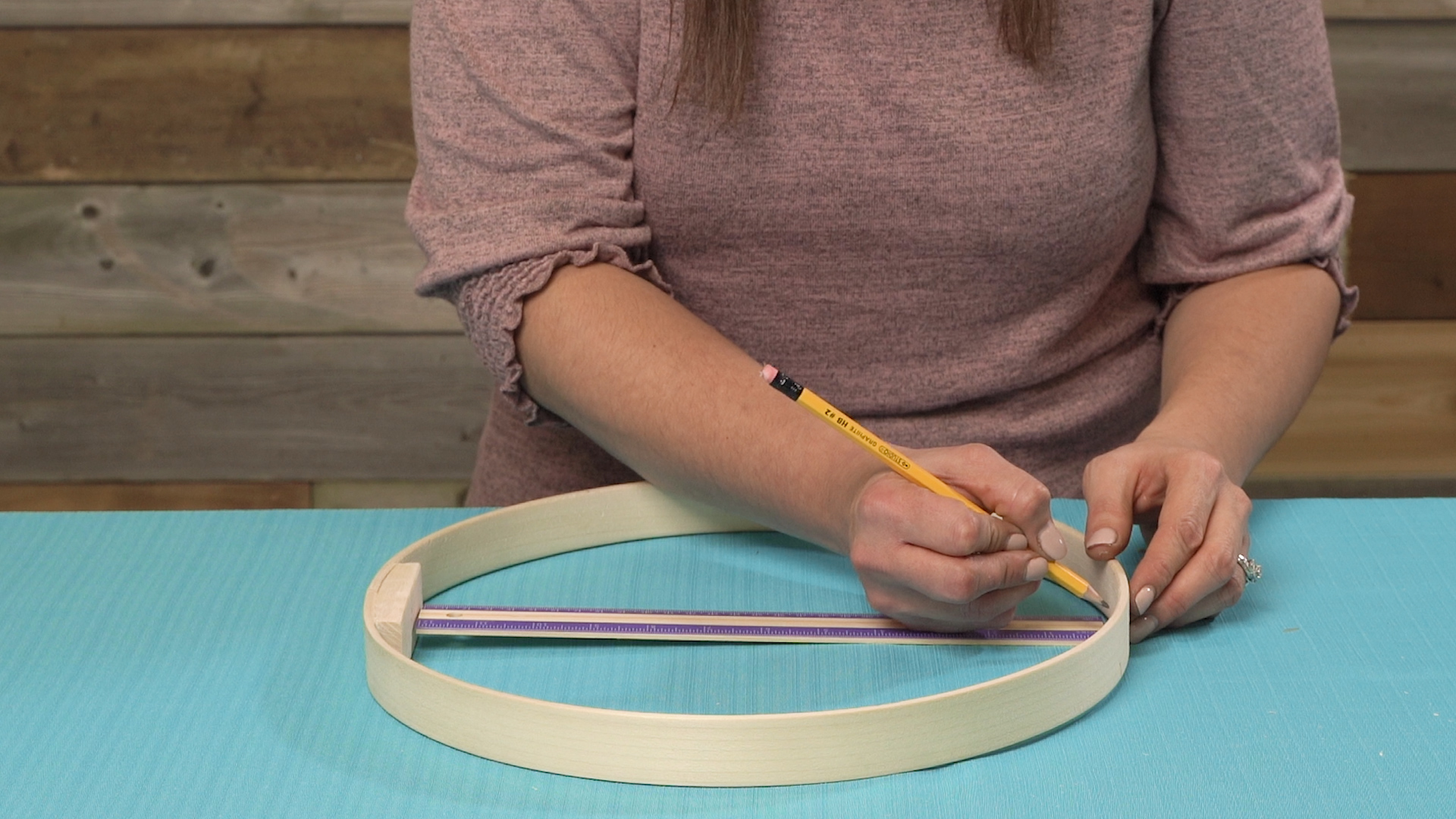 using ruler to mark center point on embroidery hoop