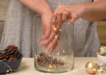 placing pine cones on top of lights