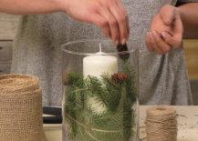 adding mini pinecones to winter centerpiece