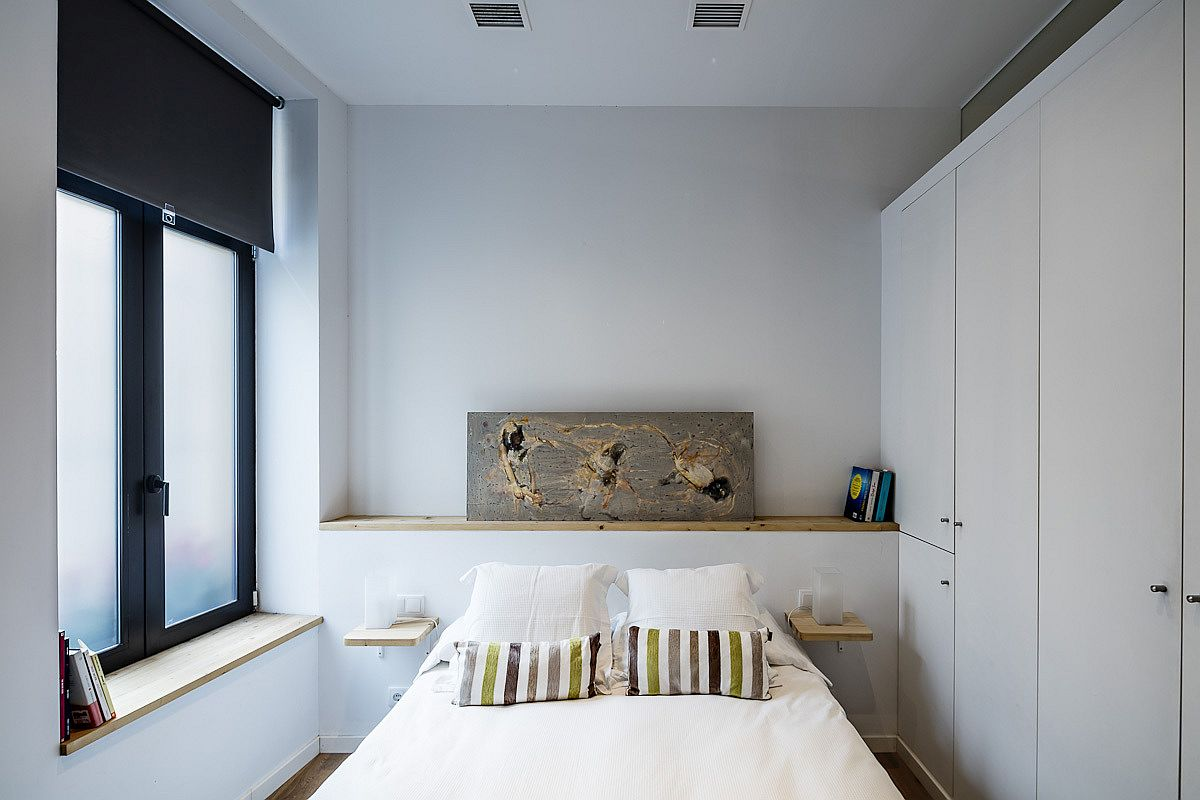 Small bedroom in white designed to maxmize space