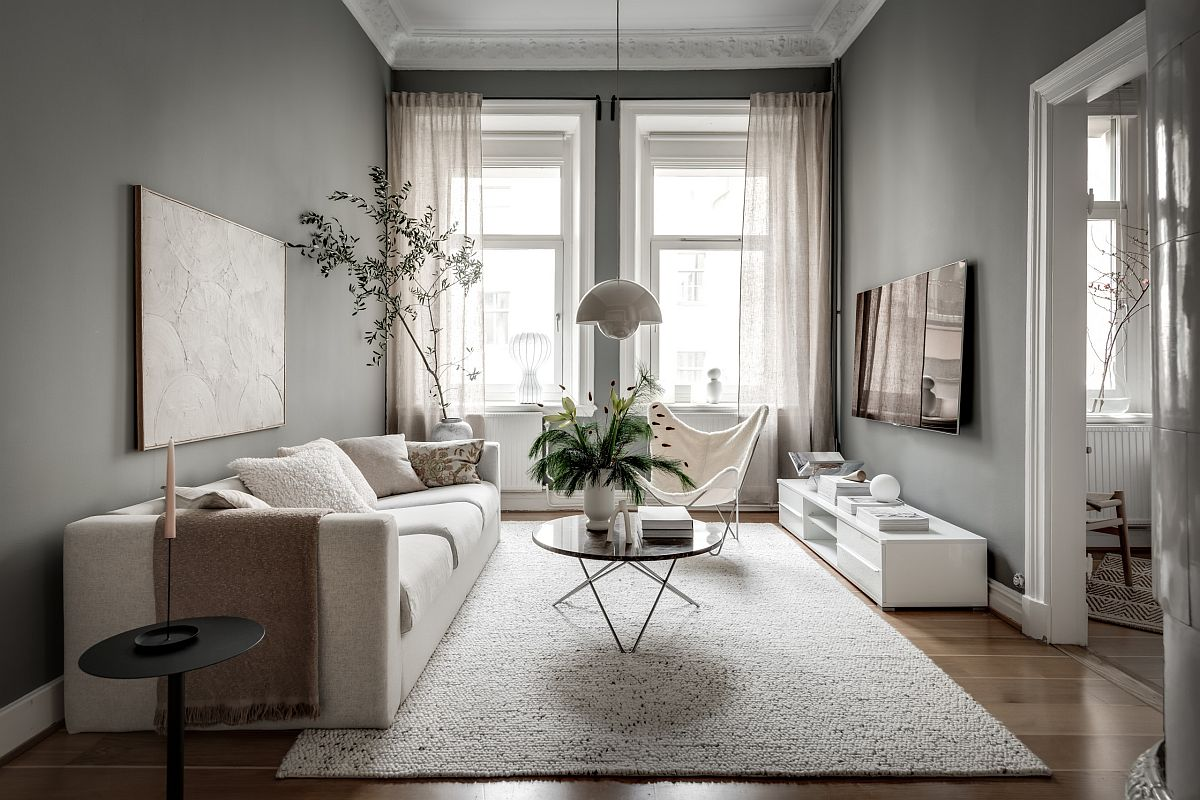 Smart and small Scandinavian style living room with gray walls and a hint of greesn