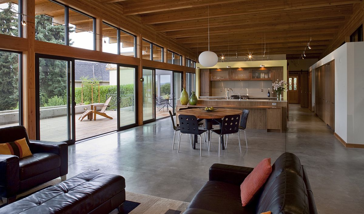 Spacious and open plan living space of the Vancouver home with a sloping roof and glass walls