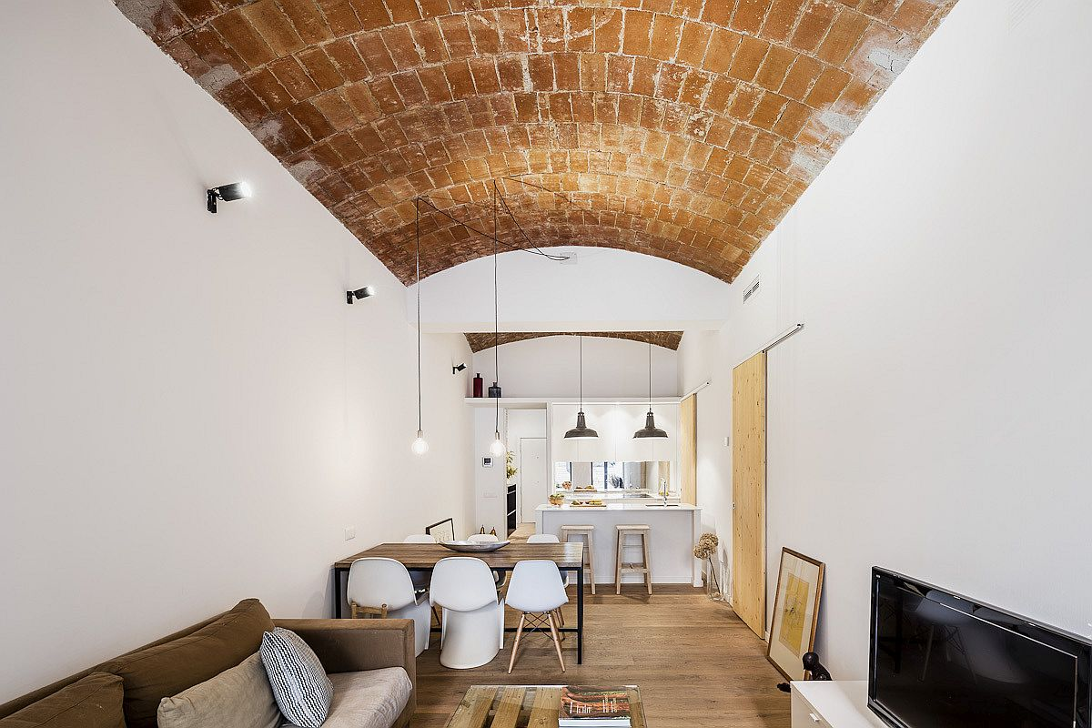 Traditional Catalan vaulted ceiling in ceramics adds delightful color and contrast to the living space