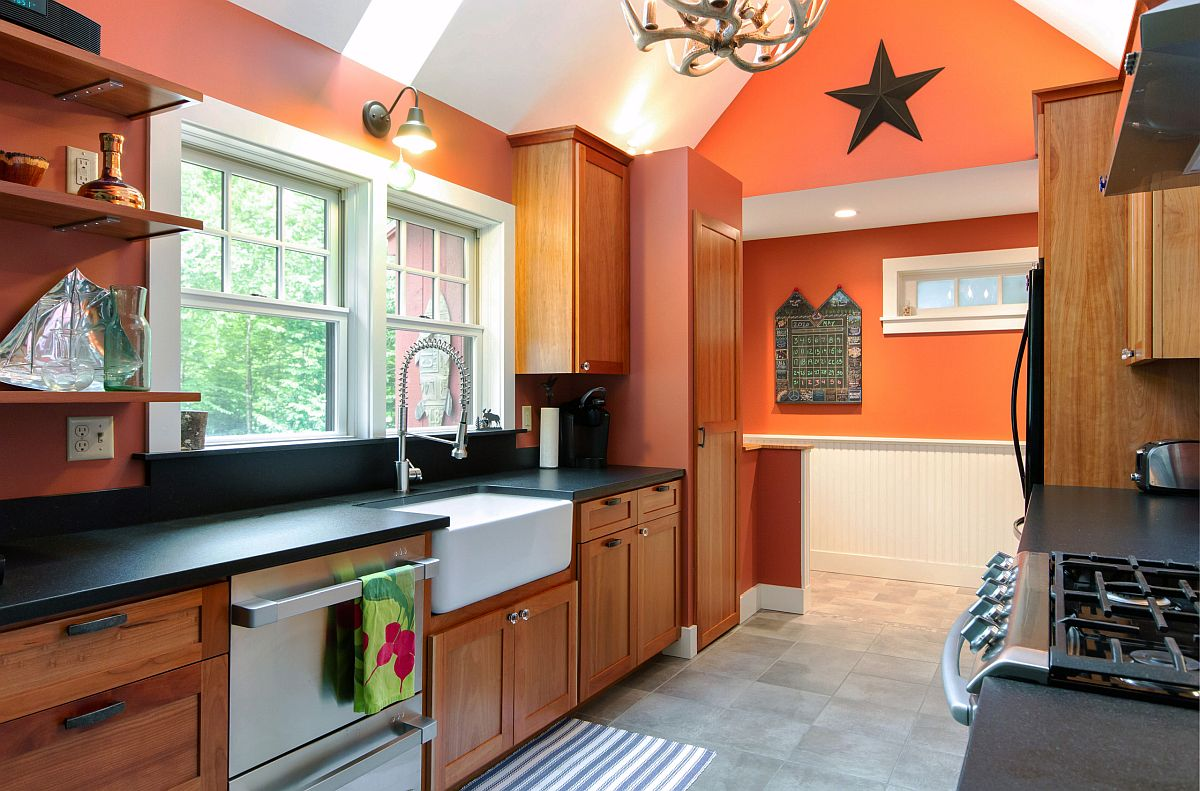 Trendy splashes of orange improve the lighting in this spacious rustic kitchen