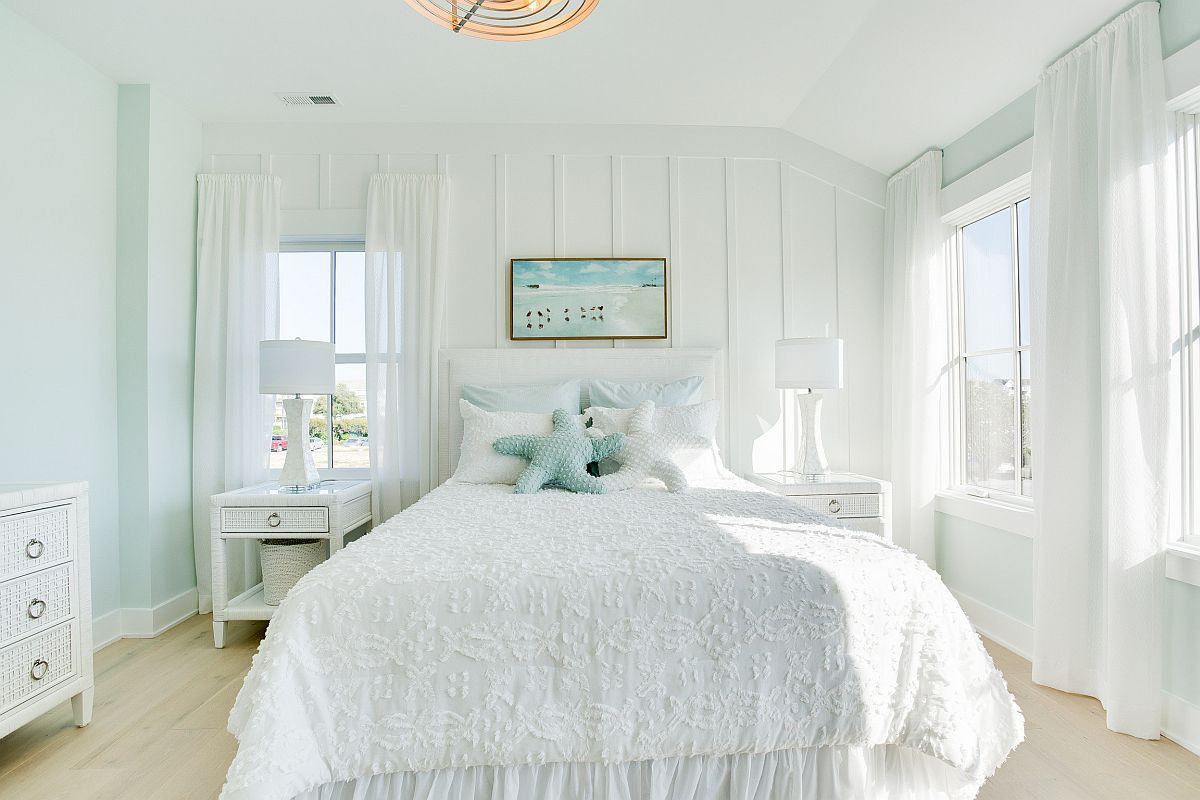 Very light pastel hues coupled with white to create a relaxing and chic bedroom
