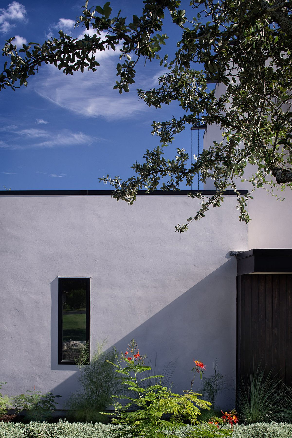 View of the private street facade of the contemporary Texas home