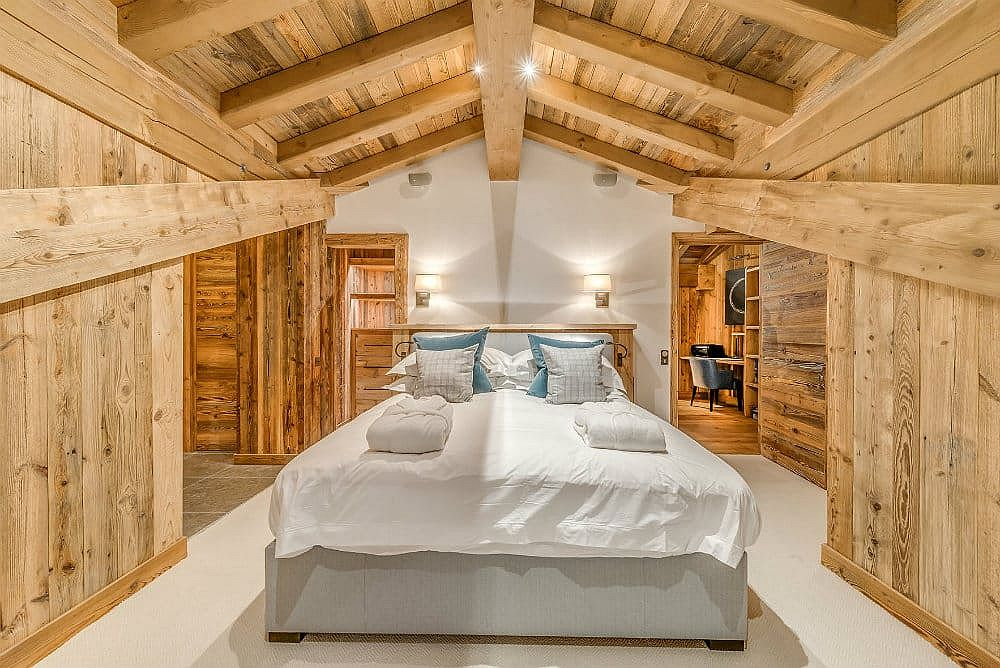Wood and white bedroom of the luxury alpine getaway in Val d'Isere