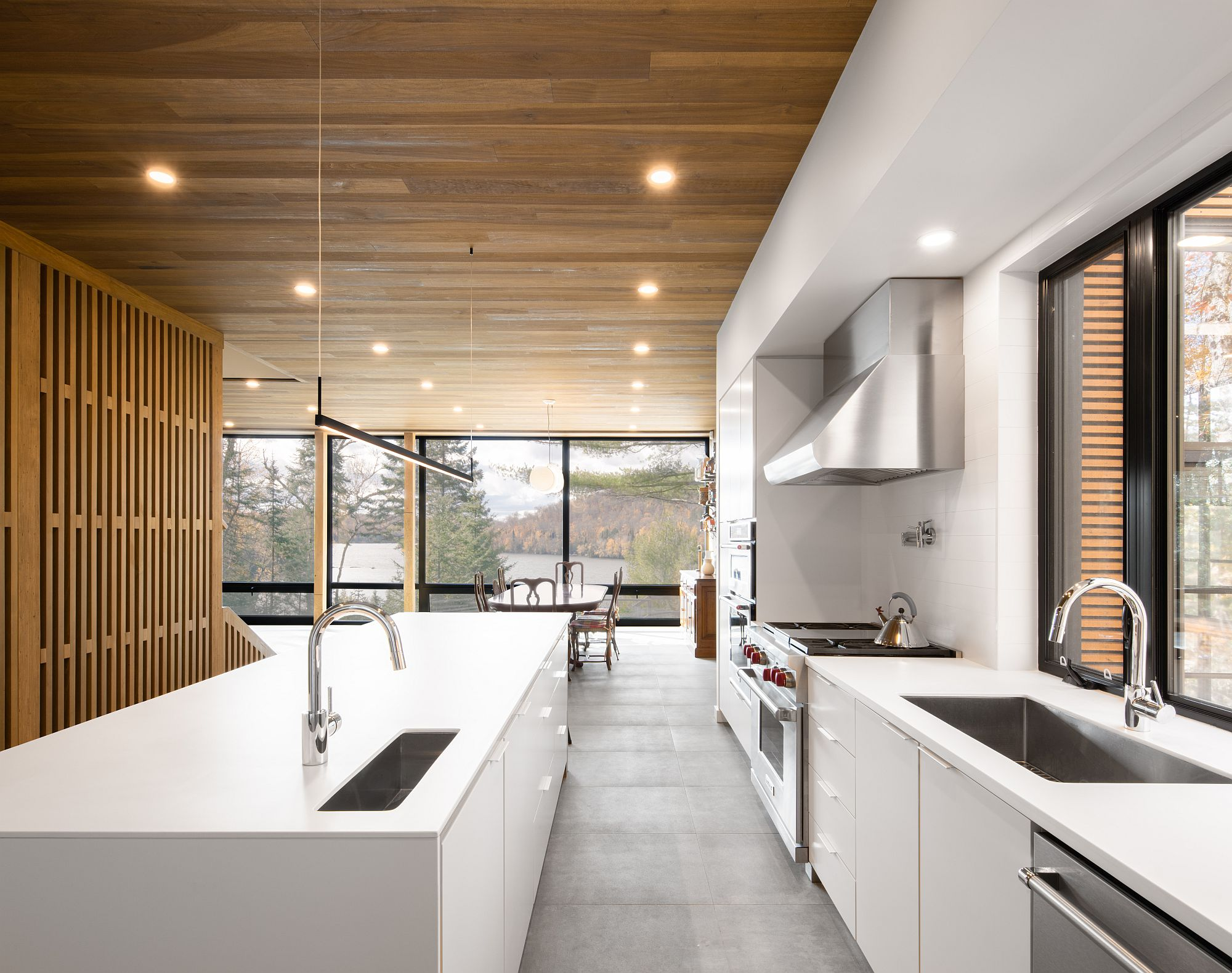 Wood and white interior of the houe with ample natural light and space-savvy design