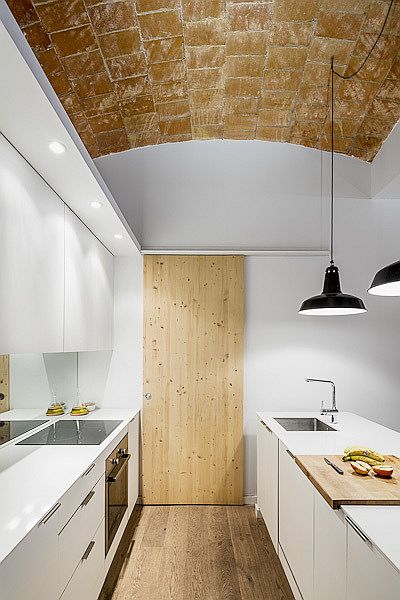 Wood, white and ceramic tiles shape the interior of this Barcelona home