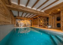 Wooden-walls-doors-and-ceiling-beams-add-warmth-to-the-indoor-swimming-pool-98733-217x155