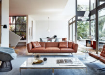 living room with marble table, metal chair, and leather couches