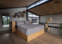 Bedroom-on-the-upper-loft-level-with-a-modern-industrial-style-91971-217x155