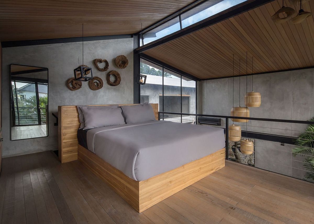 Bedroom on the upper loft level with a modern-industrial style