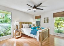 farmhouse style bedroom with shutters and bamboo window covering