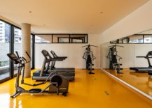 Bright-and-beautiful-yellow-floor-of-the-gym-area-grabs-your-attention-25196-217x155